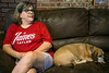 Susie Bowling sits on the couch with her dog Oscar from her home in the Hikes Lane area. 8/7/17