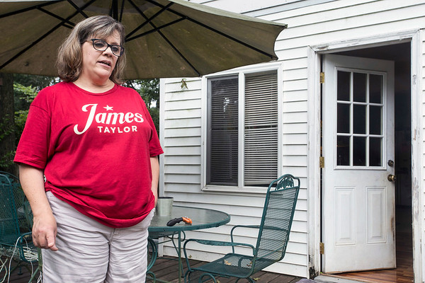 Organ donor Susie Bowling stands on the back deck of her home off of Hikes Lane. 8/7/17