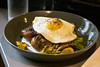The Crispy Pork Hash at The Gralehaus comes with red potatoes, roasted vegetables, verde, crema, and a sunny side up egg. 8/11/17