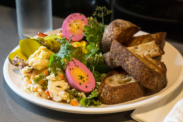 """The Picnic Plate at The Gralehaus on Baxter Avenue is a """"chef's whim of hausmade sides, spreads, pickles, and cheese served with toast."""" 8/11/17"""