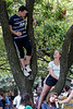Rigel Harris and Calum Bedborough got a better view from a tree in Jefferson Square as local leaders took to the stage in opposition to the actions of Virginia protesters. 8/13/17