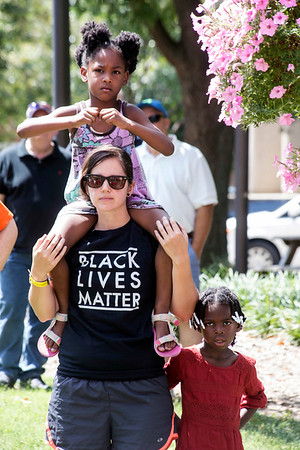 Tracy Martin listens along with Kayla and Kaleah Martin as local leaders speak out against the racial tension and protest violence seen in Virginia over the weekend. 8/13/17
