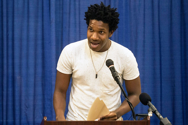 Poet Justin Jackson recited a recent piece about bigotry in America during a Wednesday rally at the state capitol rotunda. 8/16/17