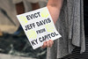Signs were carried by several attendees to a rally in the state capitol rotunda on Wednesday to express the desire to remove a statue of Jefferson Davis. 8/16/17