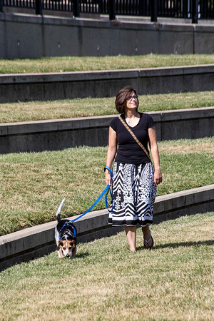 Denise Greer walks her dog Kunu on a Thursday afternoon along Jeffersonville's scenic riverfront. 8/24/17