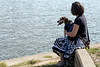 Denise Greer and her dog Kunu take a break during a walk along the river as the pair transition to the perks of a Jeffersonville lifestyle. 8/24/17