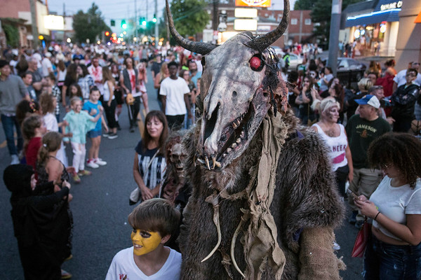 A towering ghoul was an instant hit for those with children and cameras at the annual Louisville Zombie Walk on Saturday. 8/26/17