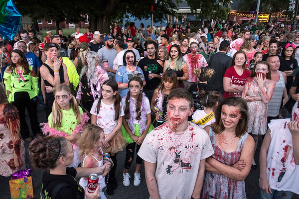 A sampling of the 40,000+ crowd at the annual Louisville Zombie Walk gathered near MidCity Mall just before the official 8:28PM start time on Saturday. 8/26/17