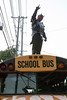 A devil atop a school bus at MidCity Mall instructed participants and spectators that the start of the Louisville Zombie Walk began at Eastern Parkway and ended at Highland Avenue. 8/26/17