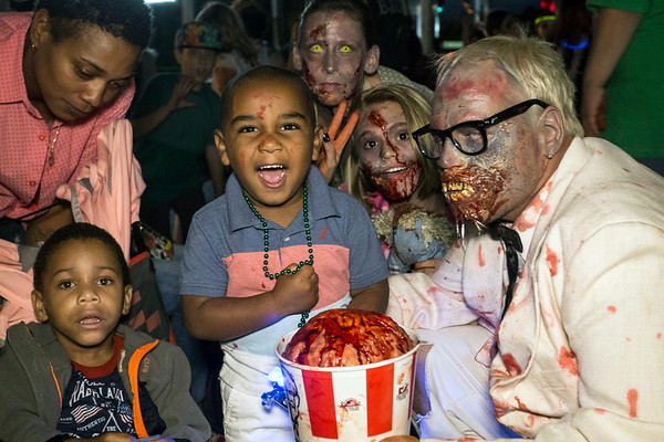 Little Haiden Jacko squealed with delight over meeting Roger Vadner's zombie Colonel Sanders during the annual Louisville Zombie Walk on Saturday. 8/26/17