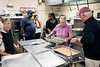 Volunteers and trainees bustle about preparing meals for the homeless and hungry on a Wednesday afternoon in the Common Table kitchen. 8/30/17