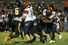 Fern Creek running back Anthony Teague gets stalled out by the Central defense during the first half of Thursday's game. 8/31/17