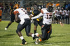 Fern Creek quarterback Isaiah Hester hands off to running back Dylan Dunbar against Central High on Thursday. 8/31/17