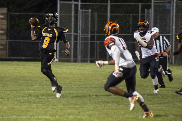 Central QB Rico White looks for the open man down field against Fern Creek on Thursday. 8/31/17