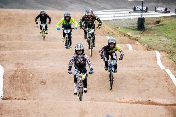 A group of young riders navigate one of the hilly straights of the Tom Sawyer State Park bike track during the Derby City BMX Nationals on Saturday. 9/2/17