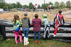 Fans and racers gather around a fenceline in Tom Sawyer State Park to watch racers compete in the Derby City BMX Nationals. 9/2/17
