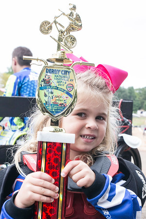 4-year-old Capri Matusic holds up the first place trophy she won in a strider race during the Derby City BMX Nationals. 9/2/17