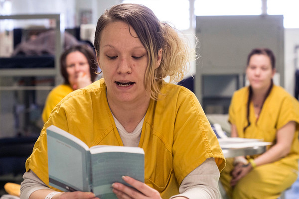 LMDC inmate Shanna Sermon reads aloud a passage from one of the numerous books used to promote personal growth and recovery in the Enough is Enough program for addicts. 9/6/17