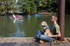 Casey Heeter and his dog Fancy watch as paddlers enter Harrods Creek for the start of the Great Ohio River Odyssey on Saturday. 9/16/17