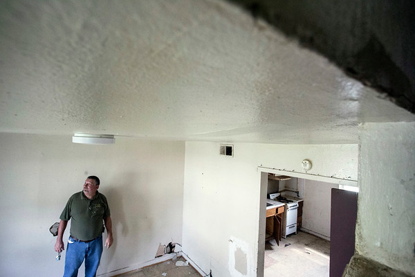 Duane Gadd, Director of Property Services for the New Albany Housing Authority, looks at a ceiling in an O. Vance unit that is slowly caving in. 9/20/17