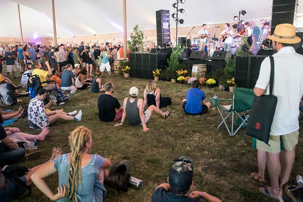People sit on the lawn of the Big Bourbon Bar tent and enjoy live entertainment at Bourbon & Beyond. 9/23/17