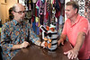 Food Network Star Jason Smith chats with Encore Resale owner Mark Estell during a visit to the Highlands consignment shop. 9/27/17