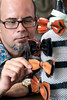 Food Network Star Jason Smith takes a closer look at some locally handcrafted, wooden bow ties at Encore Resale in the Highlands. 9/27/17