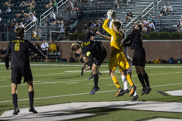 St. X goalie Haydon Korfhage defends against an attempted score by Trinity. 9/27/17