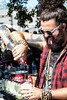 Dustin Stradling pours drinks with enthusiasm at Louder Than Life on Saturday. 9/30/17