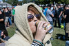 Cassidy Goodman of North Carolina enjoys a cool beverage in costume at Louder Than Life. 9/30/17