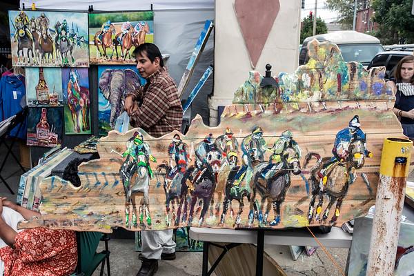 The horse racing themed art of Enrique Gonzalez was a hit duirng The St. James Court Art Show. 10/7/17