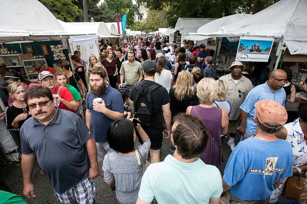 People as far as the eye could see lined 4th Street on Saturday afternoon to take in the sights of The St. James Court Art Show. 10/7/17