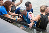 Patrick Jaberg of Switzerland emerges from the Ohio River with the aid of volunteers during the annual Louisville Ironman on Sunday. 10/15/17