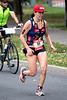 Kelly Fillnow focuses on the finish line as she begins the final leg of the 26.2 mile run during the Louisville Ironman on Sunday. 10/15/17