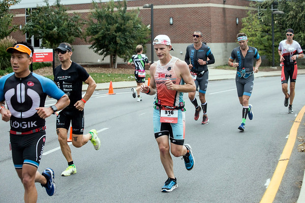 A pack of runners make the turn near Cardinal Boulevard during the Louisville Ironman on Sunday. 10/15/17