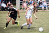 Sacred Heart's Lauren Payne moves the ball past Manual defender Sofia Mitchell during the 7th Region Soccer Final on Saturday. 10/21/17