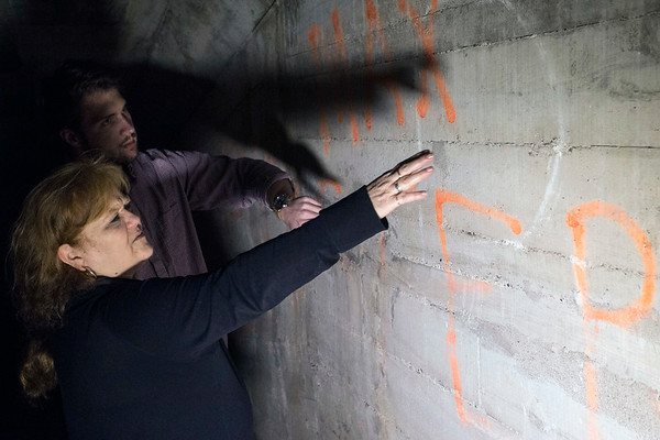 Waverly historian Tina Mattingly points out graffiti believed to be from the 1930s in the tunnel under the famous sanatorium. 10/16/17