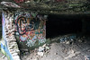 Layers of graffiti mark the entry way to a cave system in Tom Sawyer Park. 10/12/17