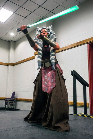 Kim Stephens shows off her Jedi moves while being judged in the costume contest at the Derby City Comic Con. 10/28/17