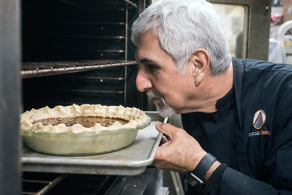 Anoosh Shariat takes a last look before baking his pecan pie for 50-60 minutes at 350-degrees. 11/7/17