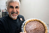 Anoosh Shariat presents his baked pecan pie. 11/7/17