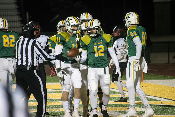 Dominic Allgeier is surrounded by teammates after scoring a touchdown against PRP. 11/10/17
