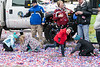 Children play in a shower of confetti that rained down at the corner of Fifth & Main during the Veterans Day Parade. 11/11/17