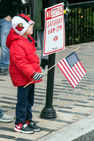 Kole Wallace watched as dozens of military vehicles and uniformed veterans march down Main Street during the Veterans Day Parade on Saturday. 11/11/17