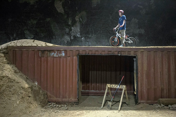 Dalton McCauley sizes up the next challenge on the bike course at the Louisville Mega Cavern. 11/22/17