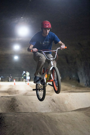 Dalton McCauley takes flight during a run down a collection of hills on the bike course at the Louisville Mega Cavern. 11/22/17