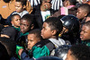 Members of the winning football team in the 5-6-7 age group wait to receive trophies at the annual Juice Bowl in Shawnee Park on Thursday. 11/23/17