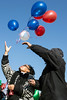 Priscilla Norment and Christopher 2X release balloons in memory of the victims effected by gunfire at the 2016 Juice Bowl at the start of the annual Thanksgiving Day football game in Shawnee Park on Thursday. 11/23/17