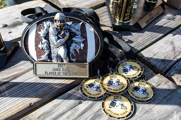 Trophies and medallions were given to the winners and participants in the annual Juice Bowl in Shawnee Park on Thursday. 11/23/17