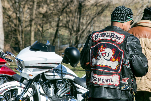 Bikers and their custom motorcycles line a road adjacent to the football field at Shawnee Park during the annual Juice Bowl on Thursday. 11/23/17